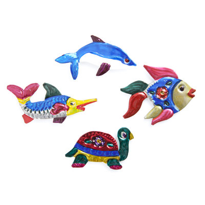 magneetjes van blik vissen en zeedieren